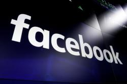 In this March 29, 2018 file photo, the logo for social media giant Facebook, appears on screens at the Nasdaq MarketSite, in New York's Times Square