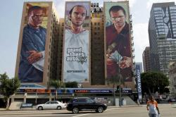 "This Sept. 10, 2013 file photo shows billboards for ""Grand Theft Auto V "" billboard on a hotel in Los Angeles."