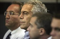 "In this July 30, 2008, file photo, Jeffrey Epstein, center, appears in court in West Palm Beach, Fla. Federal prosecutors, preparing for a bail fight Monday, July 15, 2019, say evidence against Epstein is growing ""stronger by the day"" after several more women contacted them in recent days to say he abused them when they were underage"