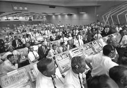 This July 1969 photo provided by NASA shows launch controllers in the firing room at the Kennedy Space Center in Florida during the Apollo 11 mission to the moon