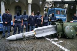 Police stand by a missile seized at an airport hangar near Pavia, northern Italy, following an investigation into Italians who took part in the Russian-backed insurgency in eastern Ukraine, in Turin, Italy, Monday, July 15, 2019