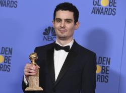 "Damien Chazelle, director and screenwriter for ""La La Land,"" in the press room with the award for best screenplay - motion picture at the 74th annual Golden Globe Awards."