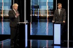 In this photo issued by ITV, showing Britain's Conservative Party leadership candidates Boris Johnson, left, and Jeremy Hunt, during a live head-to-head TV debate hosted by ITV at their studios in Salford, England, Tuesday July 9, 2019