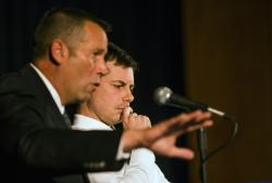 South Bend Police Chief Scott Ruszkowski, left, speaks as Democratic presidential candidate and South Bend Mayor Pete Buttigieg listens during a town hall community meeting.