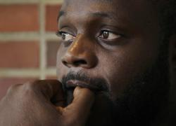 In this June 21, 2019, photo, Blaise Matshieba Nduluyele pauses as he speaks outside the Expo Center in Portland, Maine, about the dangerous journey he and his family made in order to seek asylum in the United States
