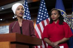 "U.S. Rep. Ilhan Omar, D-Minn., joined at right by U.S. Rep. Ayanna Pressley, D-Mass., responds to remarks by President Donald Trump after he called for four Democratic congresswomen of color to go back to their ""broken"" countries, as he exploited the nation's glaring racial divisions once again for political gain, during a news conference at the Capitol in Washington, Monday, July 15, 2019"