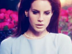 "Lana Del Rey in her ""National Anthem"" music video."