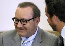 Actor Kevin Spacey listens to attorney Alan Jackson during a pretrial hearing at district court in Nantucket, Mass.