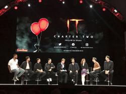 """Cast of """"It: Chapter Two"""" sit at a Comic-Con event."""