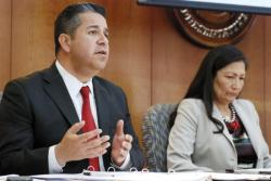 In this April 15, 2019 file photo, U.S. Reps. Ben Ray Luján, left, and Debra Haaland of New Mexico speak at a field hearing of a House Subcommittee on Energy and Mineral Resources in Santa Fe, N.M., about the affects of air pollution on sacred Native American cultural sites