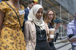 Rep. Ilhan Omar, D-Minn., a target of racist rhetoric from President Donald Trump, walks from the House to her office following votes, at the Capitol in Washington.