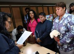 Michelle Aviles, right, and her partner Alexandra Chavez, center, get married at the Civil Registry in Guayaquil, Ecuador.