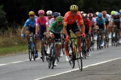 Belgium's Greg Van Avermaet, center, rides on a sidewalk during the twelfth stage of the Tour de France cycling race over 209,5 kilometers (130 miles) with start in Toulouse and finish in Bagneres-de-Bigorre, France.