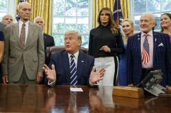 President Donald Trump, accompanied by Apollo 11 astronauts Michael Collins, left, and Buzz Aldrin, right, with Vice President Mike Pence and first lady Melania Trump.