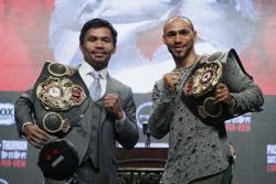 Manny Pacquiao, left, and Keith Thurman pose during a news conference Wednesday, July 17, 2019, in Las Vegas