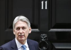 In this Wednesday, Jan 9, 2019 file photo, Britain's Chancellor of the Exchequer Philip Hammond