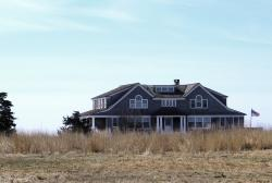In this April 2, 2019 photo, a multimillion-dollar home sits on a peninsula in Old Saybrook, Conn.