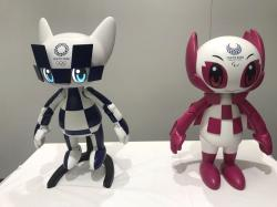 "In this Thursday, July 18, 2019, photo, robots of mascots of Olympics ""Miraitowa,"" left, and Paralympics ""Someity"" are shown to the media at Toyota Motor Corp. headquarters in Tokyo"