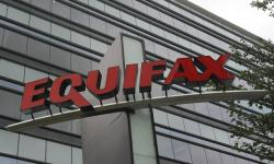 This July 21, 2012, file photo shows signage at the corporate headquarters of Equifax Inc., in Atlanta