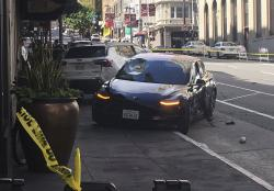 This photo taken Sunday, July 21, 2019, and provided by KGO-TV shows the scene after a woman was arrested after running a red light in a rented Tesla in San Francisco and causing a crash that killed a tourist and left his wife critically injured