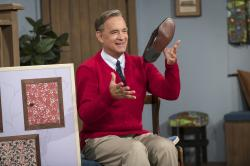 "om Hanks as Mister Rogers in a scene from ""A Beautiful Day In the Neighborhood."""