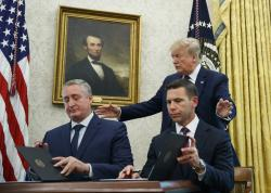 President Donald Trump, walks to acting Department of Homeland Security Secretary Kevin McAleenan, seated right, and Guatemalan Interior Minister Enrique Degenhart in the Oval Office of the White House in Washington, Friday, July 26, 2019.