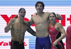United States mixed 4x100m freestyle relay team members, from left, Caeleb Dressel, Zach Apple and Mallory Comerford celebrate after winning the gold medal at the World Swimming Championships in Gwangju, South Korea.