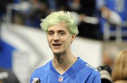 """In this Sept. 10, 2018, file photo, Fortnite superstar Tyler """"Ninja"""" Blevins watches before an NFL football game between the Detroit Lions and New York Jets in Detroit"""