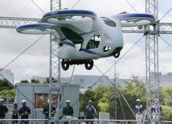 NEC Corp.'s machine with propellers hovers at the company's facility in Abiko near Tokyo, Monday, Aug. 5, 2019