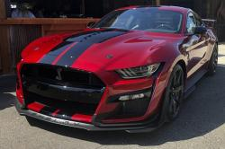 In this Tuesday, July 31, 2019, photo the the 2020 Shelby GT500 is displayed during a Ford press conference in the Detroit suburb of Clawson, Mich.