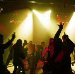 This stock photo shows revelers at a dance club