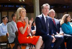 In this July 1, 2019 file photo First Partner Jennifer Siebel Newsom, left, attends a big signing ceremony with her husband, Gov. Gavin Newsom, right.