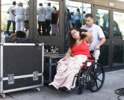 """Survivor Jessica Coca Garcia is wheeled away after speaking at League of United Latin American Citizens' """"March For a United America."""""""