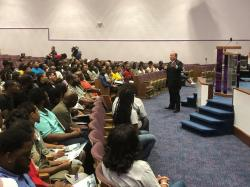 In this Aug. 6, 2019 photo, Detroit Mayor Mike Duggan speaks with Detroit residents during a job readiness event where they pre-registered to apply for jobs at a coming Fiat Chrysler assembly plant on the eastside and another nearby facility operated by the automaker