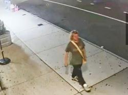 A suspect in the case of a vandal who defaced a New York City building with threatening graffiti is pictured in this screen grab from security camers video
