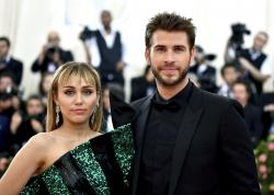 Miley Cyrus, left, and Liam Hemsworth