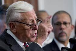House Majority Leader Steny Hoyer of Md., left, accompanied by Rep. Anthony Brown, D-Md., right, speaks at a news conference calling for Senate action on H.R. 8 - Bipartisan Background Checks Act of 2019 on Capitol Hill in Washington, Tuesday, Aug. 13, 2019