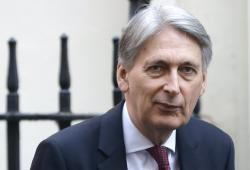 In this file photo dated Wednesday, April 10, 2019, Britain's Chancellor of the Exchequer Philip Hammond in Downing Street in London