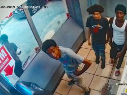 Still from surveillance video, released by the Metropolitan Police Department , showing several 'persons of interest' in the Aug. 2 beating and robbery of a transwoman
