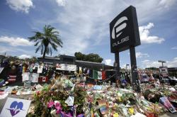 In this July 11, 2016, file photo, a makeshift memorial  outside the Pulse nightclub in Orlando