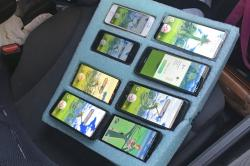 In this Tuesday, Aug. 13, 2019 photo provided by the Washington State Patrol, a piece of foam, cut to hold eight mobile phones in place -- all of them playing the game Pokemon Go -- is shown on the passenger seat of a vehicle driven by a person who was found pulled over on the shoulder of a highway in Washington state near Seattle by a Washington state trooper who thought the driver needed assistance