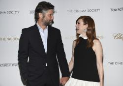 "In this Tuesday, Aug. 6, 2019 file photo, director Bart Freundlich, left, and wife, actor Julianne Moore, attend a special screening of ""After the Wedding"" in New York"