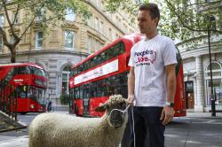 Demonstrators walk a flock of sheep through the streets as part of a protest against Brexit, in central London, Thursday, Aug. 15, 2019