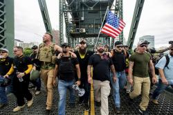 "Members of the Proud Boys and other right-wing demonstrators march across the Hawthorne Bridge during an ""End Domestic Terrorism"" rally in Portland, Ore., on Saturday, Aug. 17, 2019."
