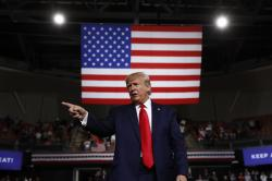 In this Aug. 15, 2019 file photo, President Donald Trump reacts at the end of his speech at a campaign rally in Manchester, N.H.