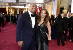 Dwayne Johnson, left, and Lauren Hashian arrive at the Oscars at the Dolby Theatre in Los Angeles.