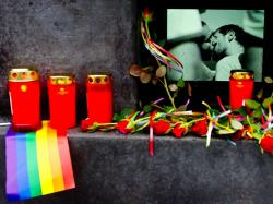 Candles and roses placed in front of the Memorial for the Homosexual Victims of National Socialism in Berlin, on Jan. 27, 2014.