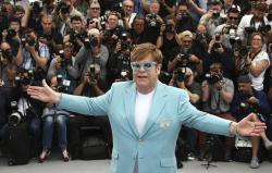 Elton John poses for photographers at the photo call for the film 'Rocketman' at the 72nd international film festival, Cannes, southern France.