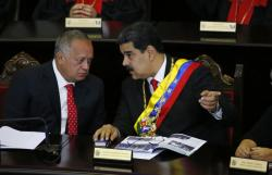 In this Jan. 24, 2019 file photo, Venezuelan President Nicolas Maduro, right, speaks with Constitutional Assembly President Diosdado Cabello at the Supreme Court during an annual ceremony that marks the start of the judicial year in Caracas, Venezuela