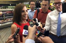 Sen. Martha McSally, R-Ariz., speaks to reporters about guns following a visit to a grocery store pharmacy in Phoenix, Thursday, Aug. 15, 2019